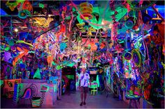 artist kenny scharf created this crazy cool neon studio space. great idea for a birthday party.
