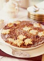 Chocolate Bourbon Pecan Pie mixes two all-time favorites: the rich, gooey texture of a pecan pie with the seductive sweetness of chocolate.