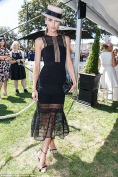 Loving that lace! Jodi Anasta, 30, ambassador for retail giant Myer was sighted at the stylish event wearing an elegant, noir dress in black lace and a jaunty boater hat tipped to the side in place of a traditional fascinator