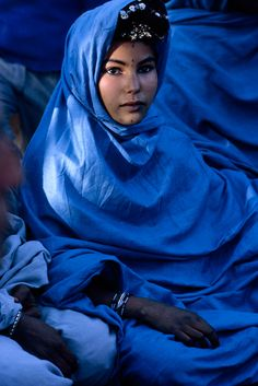A nomadic Reguibat woman in Algeria poses in traditional robes, November 1967.Photograph by Jonathan Blair, National Geographic