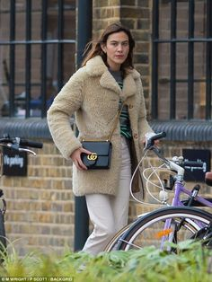 Stay warm in stripes this winter like Alexa Chung #DailyMail Click to shop now