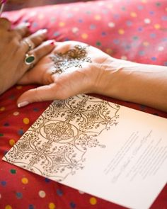 The Invitation    Gauri had her hands painted with a henna design that resembled the letterpress invitations.