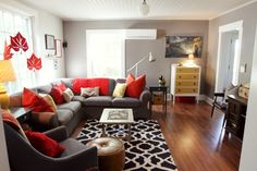 love the two-tone walls! Small room with sectional! Hate those hanging leaves