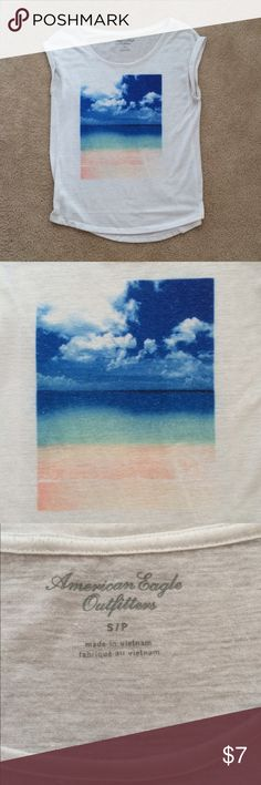 American Eagle Tee Lightweight white tee with a beach scene from American Eagle Outfitters. Size Small. Gently worn and has minor signs of pilling, but overall great condition American Eagle Outfitters Tops Tees - Short Sleeve