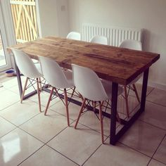 Here is our 6-8 seater dining table Made from reclaimed timber and steel The top is made from solid 2 1/2 thick timber. The grain and look of the