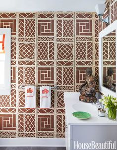 A bathroom was the perfect place to experiment with exuberant wallpaper, and its small size kept costs reasonable. Lyford Trellis wallpaper by China Seas.