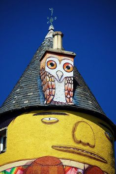 The Wise Old Owl Mural on an historic rural castle in Scotland.