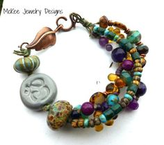 Ohm, lotus flower Ceramic, lampwork, Czech glass, metal and cording Knotted Multi strand bracelet. McKee Jewelry Designs