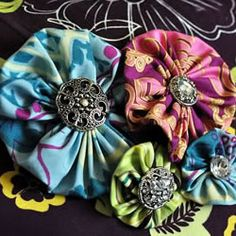 Watch our how-to video on how to make fabric yo-yo's. Then we'll show you how to decorate handbags, home decor, and more with them.
