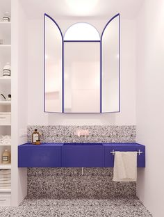 bold blue in this modern bathroom