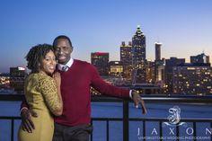 Jaxon Photography, Atlanta wedding photographers. Twilight engagement pictures at Georgian Terrace Hotel in Atlanta, GA with the downtown Atlanta skyline as a backdrop