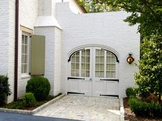 Custom Carriage doors with hand made wrought iron straps