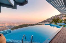 Want to add an infinity pool to your yard to take advantage of your view? Here's how much infinity pools cost and a few other things you need to consider. #swimmingpools #ingroundpool #infinityedgepool Infinity Pools, Infinity Pool Cost, Best Automatic Pool Cleaner, Beste Hotels, Pool Builders, Best Hotel Deals, Hotel Stay, Great Vacations, The Journey