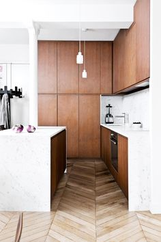 """<b>Paris match</b> In this tiny French apartment, the owner/architect ran cabinetry all the way to the three-metre ceiling. Don't forget to include a spot for a step ladder or stool to reach the highest shelves. <i>Design: <a href=""""http://camillearchitectures.com/"""" target=""""_Blank"""">Camille Hermand</a>. Styling: Lykke Foged. Photography: Morten Holtum.</i>"""