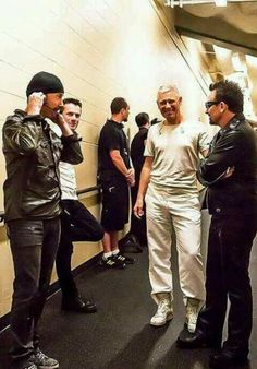 Pre-show checks. Edge screws his ears on, Bono warms his hands, and Larry wonders where the hell he put his other leg.