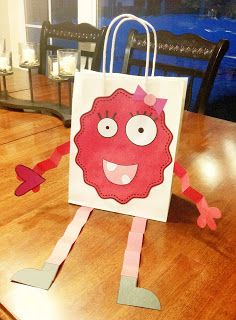 "Valentine's Day Monster Bags:  This is a cute idea for a project for February.  Girls will enjoy creating ""girly monster bags"" like this one, but boys will get excited to create ""scary monster bags.""  On the back of these bags, students can write a character description about their monsters.  On Valentine's Day, students can use these bags to place their Valentine's cards that they receive."