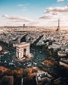 Sunrise view of Paris. Arc de Triomphe on the Champs Elysee and the Eiffel Tower. Places to see and visit on a vacation trip to Paris in Europe. Oh The Places You'll Go, Places To Travel, Travel Destinations, Places To Visit, Travel Deals, Travel Tips, Travel Photos, Paris Ville, Destination Voyage