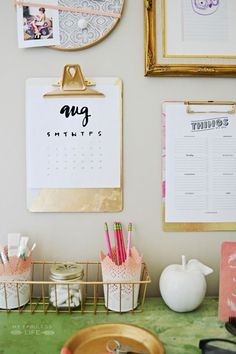 Hang clipboards on the wall and use them to hold cute prints! Painted IKEA container!
