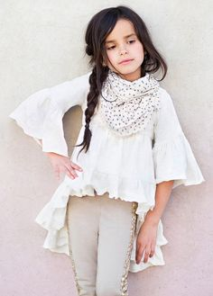 Joyfolie Boho Hi-Lo Top 8 Years ONLY (Tween Girls Joyfolie Boho Hi-Lo Top. Featuring a ruffled hem and bell sleeves, this dramatic high low top is the perfect bohemian addition to any wardrobe. We love this top paired with leggings and flats! Girls Leggings, Tops For Leggings, Little Girl Fashion, Kids Fashion, Bohemian Kids, Summer Scarves, Children's Boutique, Boho Tops, Latest Fashion Clothes