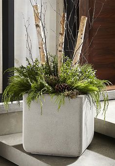 Our handsome square planters look as if they were made of heavy concrete, but their lightweight mix of fiberglass, cement and sand make them easy to position. Neutral and modern, the planter assumes a square profile, with just a hint of curve at the base to make things interesting.