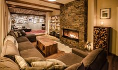 Chalet Montfort - luxury ski chalet in St Anton exclusively run by Kaluma Ski. A 10 bedroom centrally located chalet sleeping up to Group ski holidays. Small Fireplace, Living Room With Fireplace, Living Area, Living Spaces, St Anton, Sofas, Stone Interior, Separating Rooms, Ski Chalet