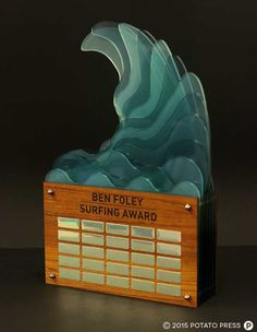 CBC FREMANTLE - SURFING MEMORIAL TROPHY  Posted: 25th September 2015Posted in: Custom Awards & Event Collateral, Design & Illustration, Laser Etching & Router Cutting This was a trophy created for CBC Fremantle for a perpetual surfing award, using custom cut layers and custom colours to create this stylised wave piece.