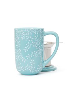 Icy blue on the outside, warm soothing tea on the inside. Nordic Mug with infuser & lid.