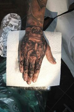 Greek god portrait tattoo on hand by Rose Price