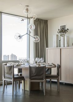 Bright Idea:  features lighting by Hudson, Gregorius   Pineo and Dessin Fournir, to name a few, so we're guessing they'll be totally on board with this sculptural chandelier in the dining area.