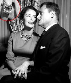 Elizabeth Taylor wearing her 29.4 carat Emerald cut engagement ring from husband, Mike Todd. She referred to it as her 'ice skating rink'