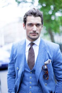 Dolce & Gabbana model David Gandy is posing for Fashional Times in a light blue suit.