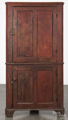 "Pennsylvania pine corner cupboard, 19th century, one-piece construction retaining a red wash, 72-1/2"" H. x 38-1/2"" W."
