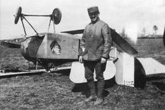Caporal Ted Parsons stands beside his overturned Nieuport scout at Ham. Note the damaged landing gear.
