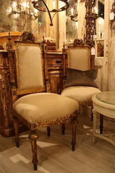 I so love looking at these wonderful old gold chairs totally ornate complimented by an off white piece of linen