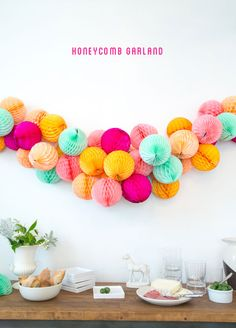 Honey comb garland http://ohhappyday.com/2013/07/honeycomb-garland-diy/