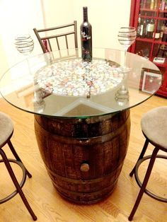 Table made from a wine barrel. I think I would like wine corks instead of the beer caps though!: