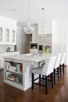 like this island design with cabinets on long side but no shelves - White and gray kitchen features white cabinets paired with New Macabus White Quartzite countertops and a white and gray herringbone tile backsplash, Ann Sacks Savoy Herringbone Tiles. Gold Kitchen, Kitchen Redo, Kitchen Dining, Kitchen Ideas, Kitchen Layout, New Kitchen Designs, Kitchen Pendants, White Quartzite Countertops, Kitchen Island With Seating