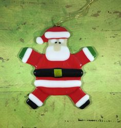 Fused Glass Christmas Ornament - Roly Poly Santa Claus  This is my own design and I like to give individual attention to each ornament I make. It measures approximately 4-1/2 by 5. I hand cut each little piece of glass and assemble and layer them all together to create this ornament. It is then fired slowly in the kiln for many hours to make it all come together. Gift box is included