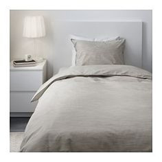IKEA - SKOGSALM, Duvet cover and pillowcase(s), Twin, , Woven fiber-dyed cotton from sustainable sources, giving the fabric a special look with fine color shifts – and you get a duvet cover which feels soft against your skin.The zipper keeps the comforter in place.