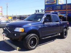 2001 F150 with Custom Light Bar  by 4 Wheel Center Inc in  TX . Click to view more photos and mod info.