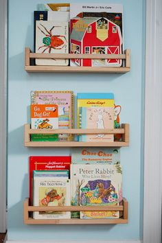 Ikea spice racks for $3.99 ea make perfect bookshelves to fill a little ones bedroom! Love it.