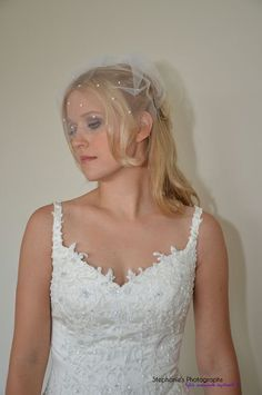 "Mini Birdcage Veil White Ivory Black 9"" Pearl and/or Rhinestone Illusion Tulle, Blusher Style, Half Face Coverage OR Angled Look. $29.99, via Etsy."