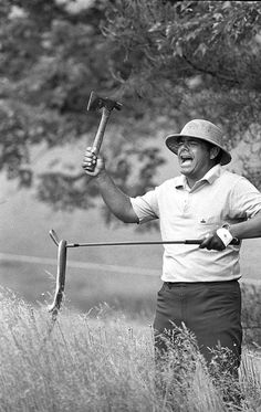 Lee Trevino wears a marshal's hat as he plays in the rough with a hatchet and rubber snake during a practice round before the U.S. Open starts at the Merion Golf Club in Ardmore, Pa. on June 16, 1971. #golf