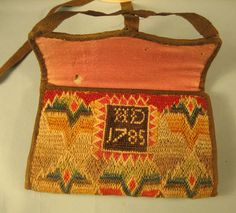 Needlework Purse - West Chester, Pennsylvania, 1785, Wool, silk, linen, and silver band.  This rare well documented item is a classic examples of what wealthy 18th c. Quaker ladies, such as the owner Hannah Darlington, would have made and used. It bears the maker's initials. Having survived in such fine condition testifies to the importance of this well executed piece. Purse-4x5.75