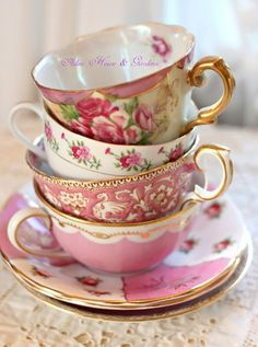 Mix Match China and use a single color to tie them all together.  This stack of pink themed tea cups works well together even though there is a variety of shapes and styles. ~MWP - Aiken House & Gardens: Soft and Pretty Tea Time