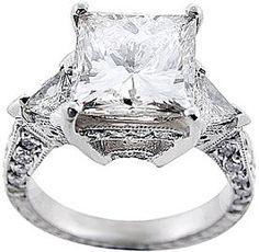 Splendid 4.00 carat triangle diamond ring: Princess cut diamond in the center set with round brilliant &   triangle cut diamonds on the antique three stone ring setting.