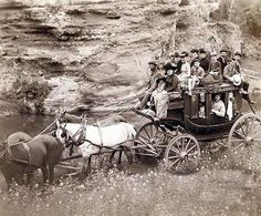 A rare image of Tallyho Coaching. Sioux City party Coaching at the Great Hot Springs of Dakota. It was taken in 1889 by Grabill, John C. H., photographer. The image shows Horse-drawn stagecoach carrying formally dressed women, children, and men.