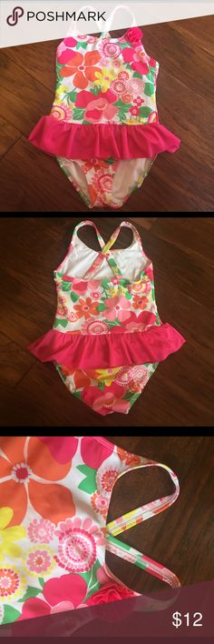 Gymboree girls one piece swimsuit size 7-8 VGUC Adorable Gymboree girls floral one piece swimsuit with ruffle size 7-8. Minor pilling on bum (see pic). Hardly noticeable at all. SO cute on! Gymboree Swim One Piece