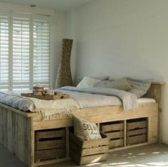 DIY ~ Pallett Bed  with Storage Crates.. some extra sanding and white wash painting or chalkboard paint could make this very special!