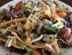 A delicious and tangy salad with southwest flavors, steak and fresh greens.- Honey Lime Dressing